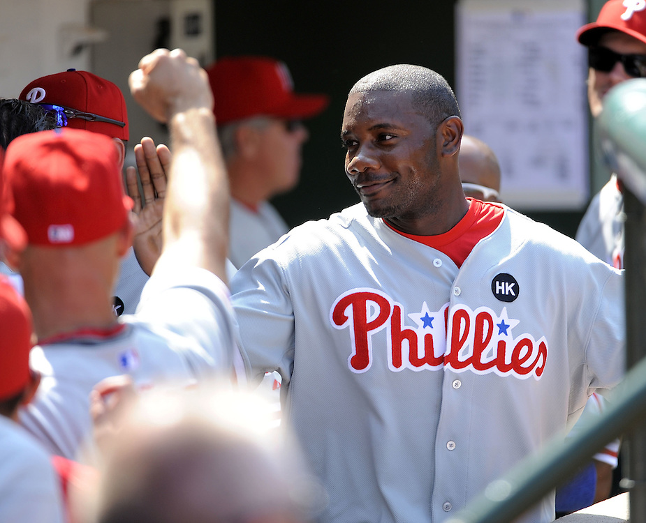 CHICAGO - AUGUST 13:  Ryan Howard #8 of the Philadelphia Phillies is greeted by teammates in the dugout during the game against the Chicago Cubs on August 13, 2009 at Wrigley Field in Chicago, Illinois.  The Phillies defeated the Cubs 6-1.  (Photo by Ron Vesely)