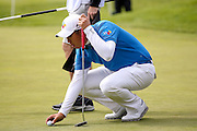 Korean golf professional Byeong Hung An lines up his putt  during the BMW PGA Championship at the Wentworth Club, Virginia Water, United Kingdom on 26 May 2016. Photo by Simon Davies.