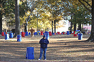 Fans and workers set up tents for tailgating, in the Grove at Ole Miss, in Oxford, Miss. on Friday, November 28, 2014. Ole Miss hosts Mississippi State in the annual Egg Bowl on Saturday at 2:30 p.m.