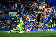 Leicester City Forward Jamie Vardy beats Chelsea Goalkeeper Thibaut Courtois (13) during the Barclays Premier League match between Chelsea and Leicester City at Stamford Bridge, London, England on 15 May 2016. Photo by Jon Bromley.