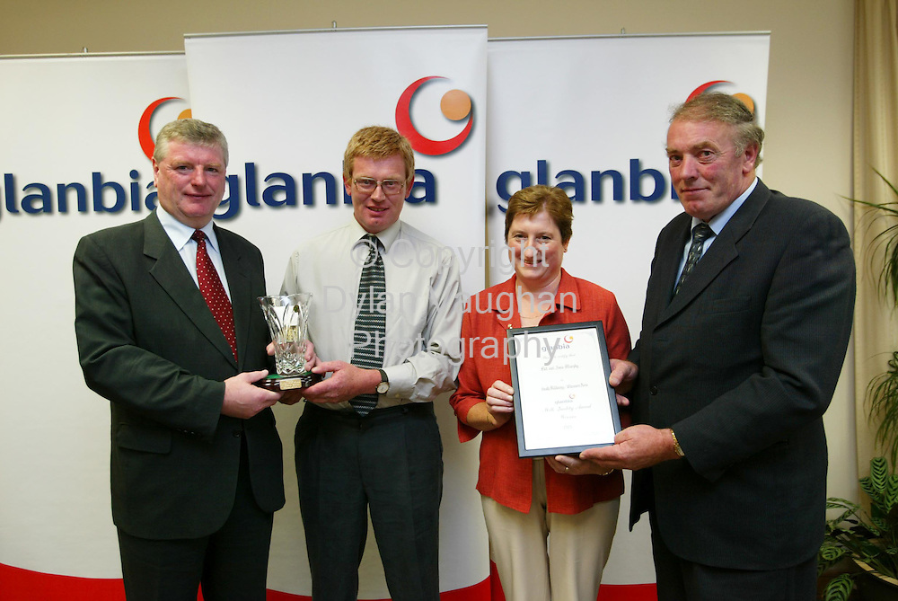 1/9/2003.Free picture No Charge..Pat and Josie Murphy from Bushpark Palace New Ross win the South Kilkenny/ Glenmore Area Glanbia Milk Quality Award Scheme..Pictured at a reception at Glanbia headquarters in Kilkenny yesterday was from left Liam Aylward Minister for State at the Department of Agriculture and Food who presented the Awards, Pat and Josie Murphy and Michael Walsh Vice Chairman Glanbia..Picture Dylan Vaughan