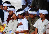 Boy dancers at Puri Agung temple waiting their turn to perform, Bali, Indonesia.