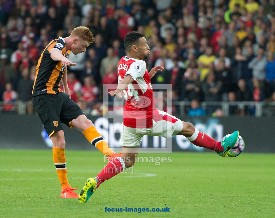 Sam Clucas of Hull City shoots at goal as Francis Coquelin of Arsenal closes down during the Premier League match at the KCOM Stadium, Hull<br /> Picture by Russell Hart/Focus Images Ltd 07791 688 420<br /> 17/09/2016