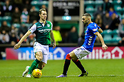 Florian Kamberi (#22) of Hibernian plays a short pass around the challenge of Eros Grezda (#35) of Rangers during the Ladbrokes Scottish Premiership match between Hibernian and Rangers at Easter Road, Edinburgh, Scotland on 19 December 2018.