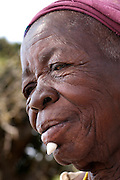 Benin, Boukoumbe December 01, 2006 - Old woman with a stone below the lip. Representation of the richness