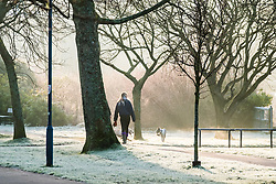 © Licensed to London News Pictures. 11/01/2018. Aberystwyth, UK. People walking in the park on a bitterly cold and frosty morning in Aberystwyth, with temperatures well below freezing after a night of clear cloudless skies. The Met Office has issued a yellow warning for fog, with very low visibility, for much of Wales, the west Midlands and the south west of the UK. Photo credit: Keith Morris/LNP