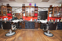 Chairs and wall mirrors in salon