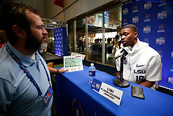 K'Lavon Chaisson #18 of the LSU Tigers speaks with the media at Media Day on Thursday, Dec. 26, in Atlanta. LSU will face Oklahoma in the 2019 College Football Playoff Semifinal at the Chick-fil-A Peach Bowl. (Jason Parkhurst via Abell Images for the Chick-fil-A Peach Bowl)