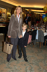 LUCY SANGSTER wife of Ben Sangster and her son OLIVER SANGSTER at a children's party in aid of the charity Over The Wall held at Fortnum & Mason, Piccadilly, London before a gala premiere of the new musical Mary Poppins at The Prince of Wales Theatre, Old Compton Street, London W1<br />