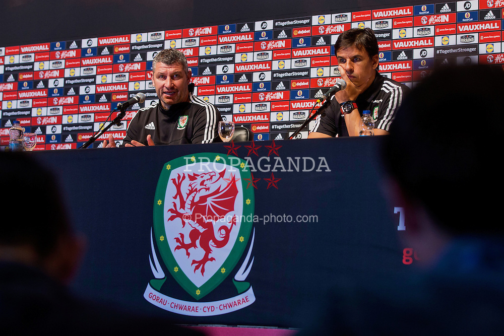 DINARD, FRANCE - Monday, June 27, 2016: Wales manager Chris Coleman and assistant manager Osian Roberts during a press conference at their base in Dinard as they prepare for the Quarter-Final match against Belgium during the UEFA Euro 2016 Championship. (Pic by Paul Greenwood/Propaganda)