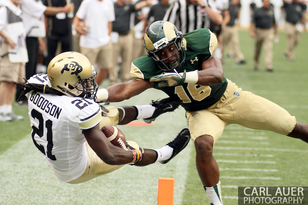 September 1st, 2013 - Colorado Buffaloes junior wide receiver D.D. Goodson (21) is knocked out of bounds at the one yard line by Colorado State Rams red shirt sophomore safety Trent Matthews (16) in the second half of the NCAA football game between the Colorado Buffaloes and the Colorado State Rams at Sports Authority Field in Denver, CO
