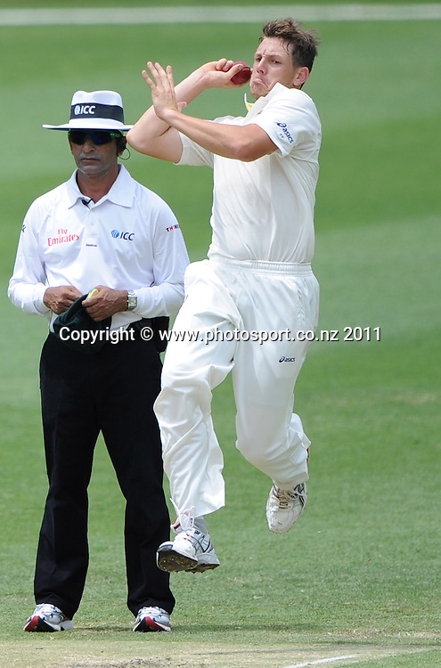 Australian bowler James Pattinson in action on Day 4 of the first cricket test between Australia and New Zealand Black Caps at the Gabba in Brisbane, Sunday 4 December 2011. Photo: Andrew Cornaga/Photosport.co.nz