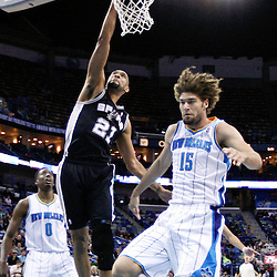 Jan 7, 2013; New Orleans, LA, USA; San Antonio Spurs power forward Tim Duncan (21) dunks over New Orleans Hornets center Robin Lopez (15) during the first quarter of a game at the New Orleans Arena. Mandatory Credit: Derick E. Hingle-USA TODAY Sports