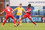 York City defender, on loan from Arsenal, Stefan OConnor  tackles Accrington Stanley forward Billy Kee  during the Sky Bet League 2 match between York City and Accrington Stanley at Bootham Crescent, York, England on 28 November 2015. Photo by Simon Davies.