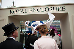 © London News Pictures. 18/06/2013. Ascot, UK.  Day one of Royal Ascot at Ascot racecourse in Berkshire, on June 18, 2013.  The 5 day showcase event,  which is one of the highlights of the racing calendar, has been held at the famous Berkshire course since 1711 and tradition is a hallmark of the meeting. Top hats and tails remain compulsory in parts of the course. Photo credit should read: Ben Cawthra/LNP