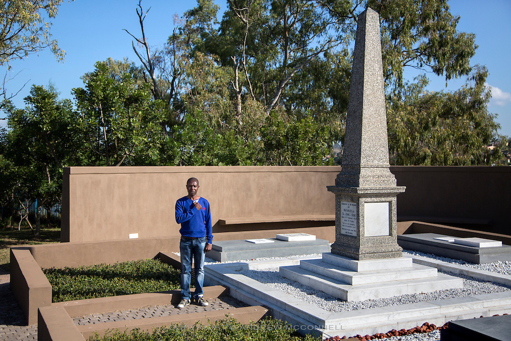 "Mandla Nxumalo, 42, pictured beside the grave of John Dube at the Ohlange High School, in Inanda, South Africa. John Dube was the founding president of the South African Native National Congress (SANNC), which became the African National Congress in 1923. After casting his vote in 1994, Nelson Mandela visited the grave and said, ""Mr President, I have come to report to you that South Africa is now free."""