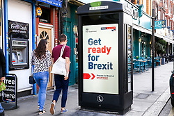 "© Licensed to London News Pictures. 02/09/2019. London, UK. People walk past a ""Get ready for Brexit"" digital advert on the back of a telephone box in north London.<br /> Today the UK Government launches a £100-million no-deal public information campaign with the slogan ""Get ready for Brexit"" as MPs attempt to delay Brexit. The campaign is hailed as the biggest government advertising drive since the Second World War. It is meant to ensure that businesses and the public are prepared in case Britain departs the EU without an agreement on October 31.<br /> Photo credit: Dinendra Haria/LNP"