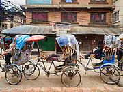 06 AUGUST 2015 - KATHMANDU, NEPAL: Pedicab drivers in the Thamel neighborhood of Kathmandu wait for fares.     PHOTO BY JACK KURTZ