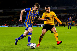 Greg Docherty of Shrewsbury Town takes on Romain Saiss of Wolverhampton Wanderers - Mandatory by-line: Robbie Stephenson/JMP - 05/02/2019 - FOOTBALL - Molineux - Wolverhampton, England - Wolverhampton Wanderers v Shrewsbury Town - Emirates FA Cup fourth round replay
