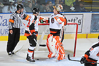 KELOWNA, CANADA, OCTOBER 11: Tyler Bunz #30 of the Medicine Hat Tigers takes a break after making a save as the Medicine Hat Tigers visited the Kelowna Rockets on October 11, 2011 at Prospera Place in Kelowna, British Columbia, Canada (Photo by Marissa Baecker/shootthebreeze.ca) *** Local Caption ***Tyler Bunz;