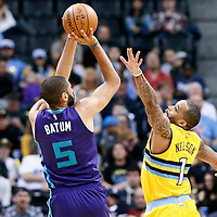 04 March 2017: Charlotte Hornets guard Nicolas Batum (5) takes a jump shot over Denver Nuggets guard Jameer Nelson (1) during the Charlotte Hornets 112-102 victory over the Denver Nuggets, at the Pepsi Center, Denver, Colorado, USA.