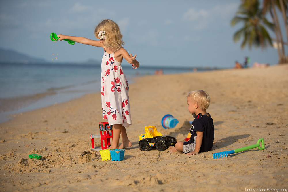 Children playing on the beach at Sea and Sky beach front restaurant located on Ban Tai beach, Koh Samui, Thailand