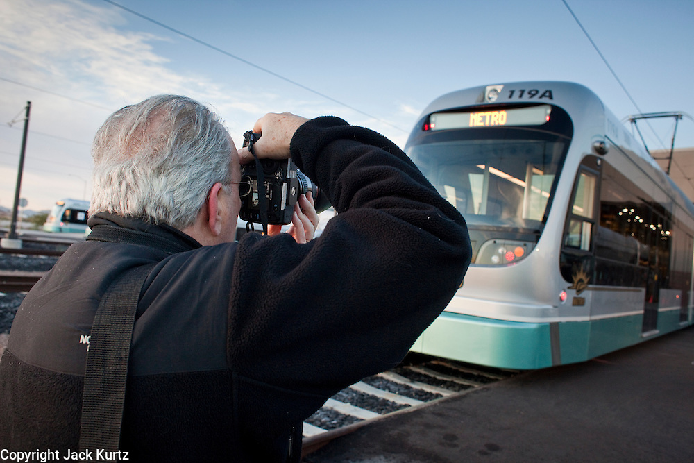 27 DECEMBER 2008 -- PHOENIX, AZ: David Sailors (CQ) from New York, photographs a light rail train Saturday. Metro Light Rail started running Saturday, Dec. 28. The light rail line is 20 miles long and cost $1.4 billion dollars. PHOTO BY JACK KURTZ