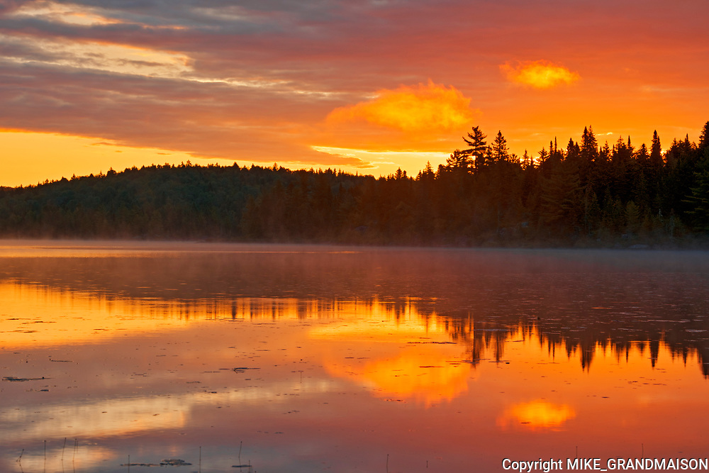 Sunrise reflection on Lac du fou<br />