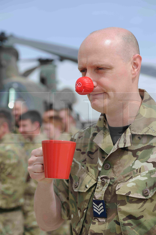 © under license to London News Pictures. 18/03/2011. Sergeant Jim Brown from 1310 Flight working with the Chinooks at Camp Bastion in Afghanistan has a cup of tea before taking part in a charity event for Red nose day today (18/.03/2011). The airmen and airwomen pulled a Chinook helicopter across 70 metres . The helicopter weighs just over 18 tonnes and is part of one of the busiest flight lines in Europe, transporting troops and equipment across Afghanistan. Photo credit should read: Sergeant Alison Baskerville/LNP
