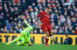 LIVERPOOL, ENGLAND - Saturday, February 24, 2018: Liverpool's Roberto Firmino beats West Ham United's goalkeeper Adrian San Miguel del Castillo to score the third goal during the FA Premier League match between Liverpool FC and West Ham United FC at Anfield. (Pic by David Rawcliffe/Propaganda)
