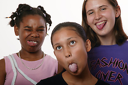 Multiracial group of teenage girls pulling funny faces,