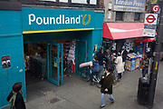 A boy on a bike holds an inflatable penis outside a Poundland on the Walworth Road, on 31st March 2017, in south London, England.