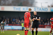 Josh Yorwerth receives a yellow card during the EFL Sky Bet League 2 match between Crawley Town and Grimsby Town FC at the Checkatrade.com Stadium, Crawley, England on 26 November 2016. Photo by Jarrod Moore.