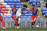 Izzy Brown of Leeds United U23 passes under pressure during the U23 Professional Development League match between U23 Crystal Palace and Leeds United at Selhurst Park, London, England on 15 April 2019.