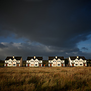 CLOONFAD, IRELAND - NOVEMBER 20, 2013: General view of unoccupied houses at West View housing estate in Cloonfad, a small town in County Roscommon. West View, one of the many housing projects in rural Ireland build during the property boom, is set in an isolated agriculture field i the edge of the town. Few houses in the estate have been sold and are occupied. The remaining are mostly unfinished and, although with windows and doors boarded, are been decayed by the elements and vandalism. CREDIT: Paulo Nunes dos Santos for The New York Times