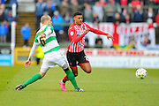 Exeter City's Ollie Watkins is caught by Yeovil Town's Jakub Sokolik but is booked for diving during the Sky Bet League 2 match between Yeovil Town and Exeter City at Huish Park, Yeovil, England on 9 April 2016. Photo by Graham Hunt.