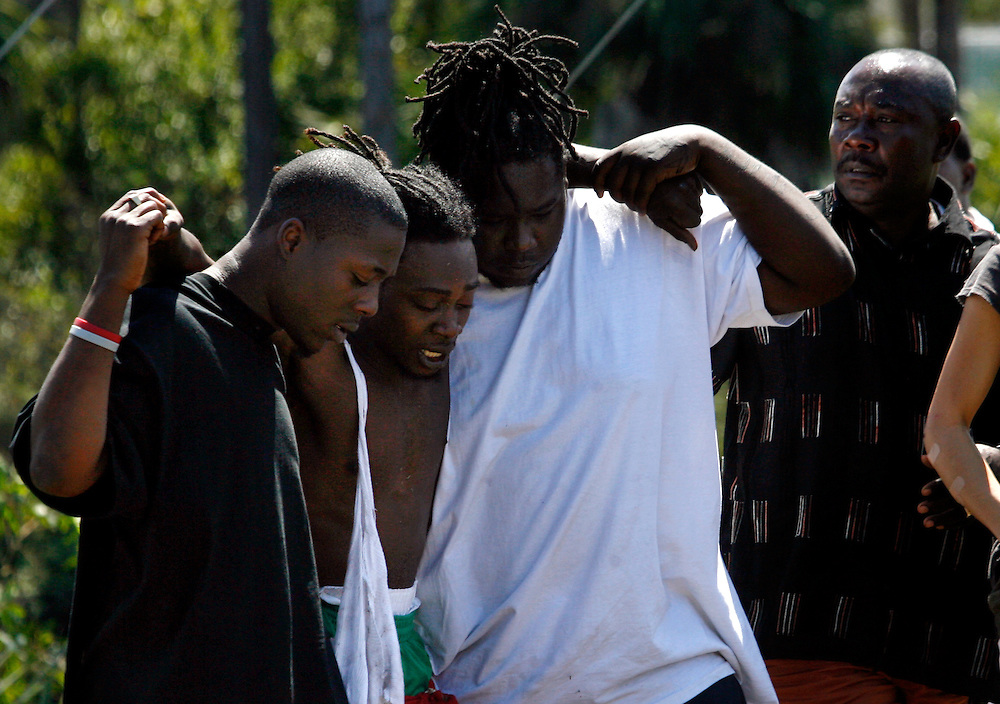 Doodley Nasaire, second from left, followed by his father Mezaus Nasaire, right, is carried away by friends from the canal where his brother was Tasered by Collier sheriff deputies and died Tuesday morning in East Naples. Nasaire's brother, Muszack Nazaire, 24, of Immokalee was driving on a suspended license, fled law enforcement authorities and was Tasered by deputies, according to Nazaire's father. According to the Sheriff department, the man who died was spotted driving in a vehicle, along with two other men, around 4:30 a.m., after sheriffs dispatchers received a call about an individual driving without a license in East Naples..Deputies tried to stop the vehicle at Estey and San Remo avenues, but the driver refused to stop and headed into Golden Gate. After a brief pursuit, the driver drove through the backyard of a residence and into a canal on 55th Terrace Southwest. He drove the car partially into the water. He then fled into the canal and swam away. The two passengers were taken out of the car by deputies.Lexey Swall/Staff