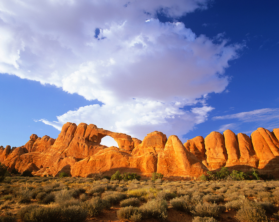 0301-1077LVT ~ Copyright: George H.H. Huey ~ Skyline Arch, with summer clouds.  Arches National Park, Utah