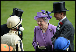 The Queen talks the jockey's in the parade ring. After her horse Estimate wins the Gold Cup at Royal Ascot 2013 Ascot, United Kingdom,<br /> Thursday, 20th June 2013<br /> Picture by Andrew Parsons / i-Images