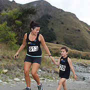 Runners Kirsty Wyndham and Charlotte Wyndham cross Moke Creek on the Ben Lomond High Country Station during the Pure South Shotover Moonlight Mountain Marathon and trail runs. Moke Lake, Queenstown, New Zealand. 4th February 2012. Photo Tim Clayton