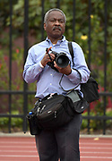 U.S. District Court Judge Percy Anderson takes photos with Nikon cameras during an NCAA college dual meet between the UCLA Bruins and the Southern California Trojans in Los Angeles, Sunday, April 28, 2019.  <br /> . 2019.