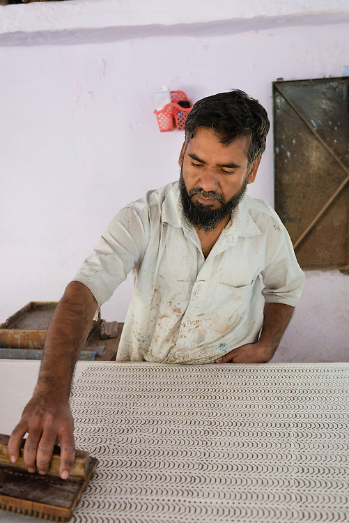 Man block printing using traditional methods