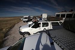 NAMIBIA ETOSHA 29APR14 - Tourists in an assortment of 4x4 vehicles and buses observe a lion hunt at a waterhole near Okaukuejo, Etosha National Park, Namibia.<br /> <br /> jre/Photo by Jiri Rezac<br /> <br /> &copy; Jiri Rezac 2014