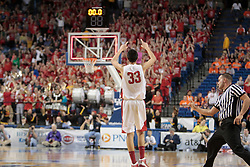 Bullitt East's Derek Willis hit a three point basket to end the first half. against Bardstown. Bullitt East hosted Bardstown in 7th game of  the 2011 PNC/ KHSAA Boys Sweet 16, Thursday, March 17, 2011. Photo by Jonathan Palmer