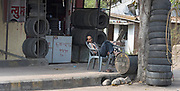 Man selling tires in Nagpur, India.