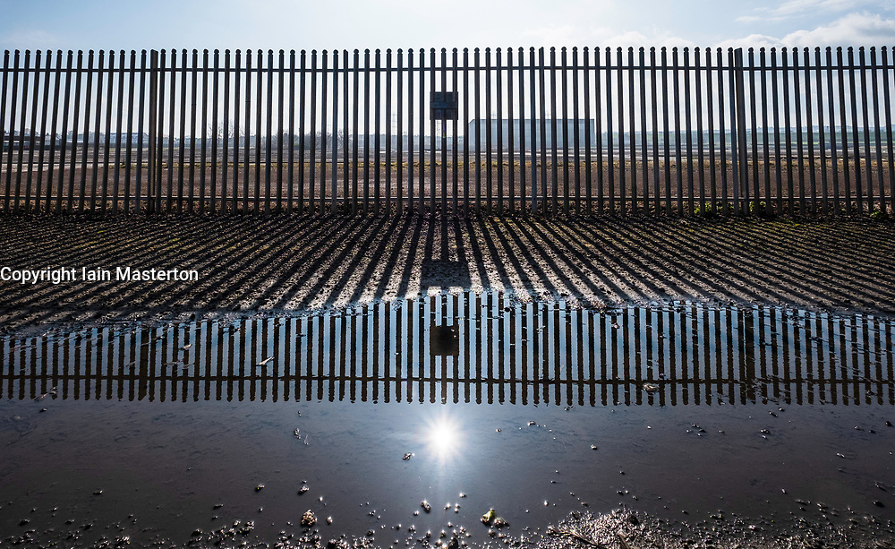 """Cockenzie, UK. 14 April, 2018. Site of the former Cockenzie power station in East Lothian, Scotland. A row has begun over concerns about the Scottish government's decision to """"call in"""" a planning application by Red Rock Power to build a renewable energy sub-station on the site. Red Rock Power, part of China's largest state-owned investment fund, the State Development and Investment Corporation (SDIC), wants the the sub-station to allow it  to feed power from the Inch Cape offshore wind farm, near Angus, into the national grid."""