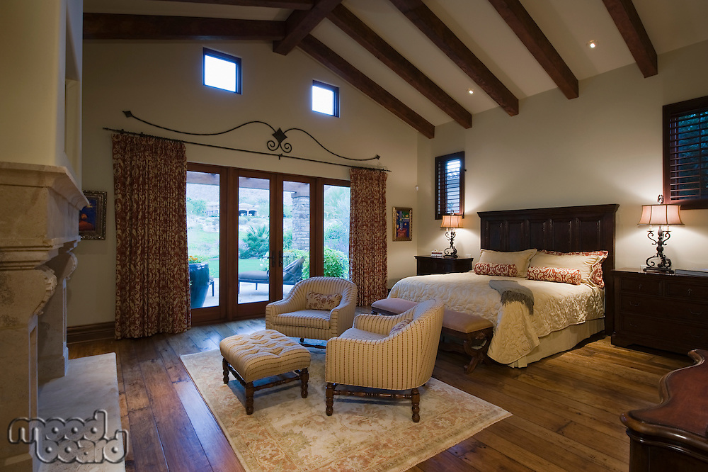 Seating area in beamed Palm Springs bedroom