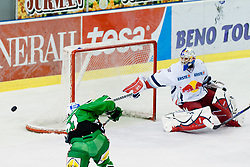 Big miss by Tomi Mustonen (HDD Tilia Olimpija, #21) on almost empty net while Joshua Tordjman (EC Red Bull Salzburg, #39) is on the wrong side of the goal during ice-hockey match between HDD Tilia Olimpija and EC Red Bull Salzburg in 20th Round of EBEL league, on November 6, 2011 at Hala Tivoli, Ljubljana, Slovenia. HDD Tilia Olimpija won in overtime 3:2. (Photo By Matic Klansek Velej / Sportida)