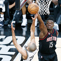 01 May 2017: San Antonio Spurs guard Tony Parker (9) is blocked by Houston Rockets center Clint Capela (15) during the Houston Rockets 126-99 victory over the San Antonio Spurs, in game 1 of the Western Conference Semi Finals, at the AT&T Center, San Antonio, Texas, USA.