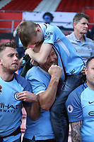 Football - 2017 / 2018 Premier League - Southampton vs. Manchester City<br /> <br /> A young Man City fan celebrates with his Dad after Kyle Walker handed the young fan his shirt after the final whistle at St Mary's Stadium Southampton<br /> <br /> COLORSPORT/SHAUN BOGGUST